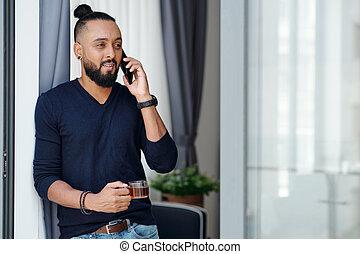 Positive man talking on phone