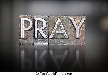 The word PRAY written in vintage lead letterpress type