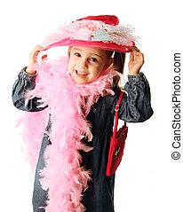 Preschool girl playing dress up