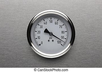 Pressure gauge shot on stainless steel background