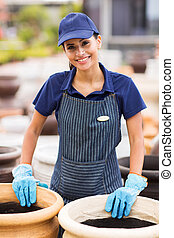 female worker at home and garden store