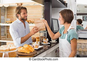 Pretty waitress serving happy
