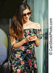 Pretty woman checking her phone