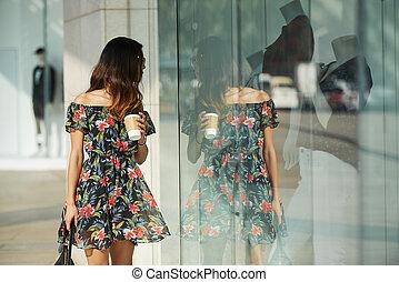 Pretty woman walking in the street
