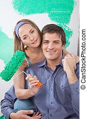 Pretty woman with arm around her boyfriend