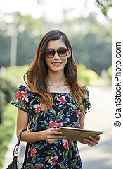 Pretty woman with digital tablet