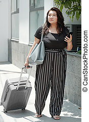 Pretty woman with luggage