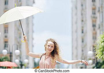 Pretty woman with umbrella