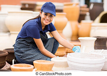 hardware store worker working in home and garden center