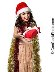 Pretty young woman holding a christmas gift