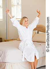 pretty young woman in pajamas just wake up