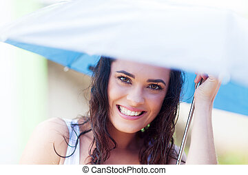 pretty young woman under umbrella