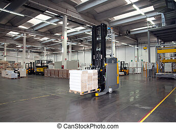 Automated warehouse (paper) with robotic forklift in a large printing industry.