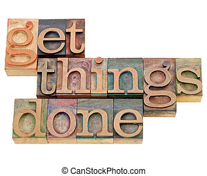 productivity or motivation reminder - get things done - isolated text in vintage wood letterpress printing blocks