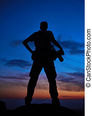 professional photographer silhouette at sunset or sunrise
