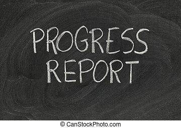 progress report headline handwritten with white chalk on blackboard with eraser smudges