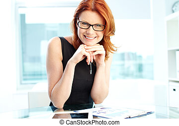 Successful business woman laughing at camera