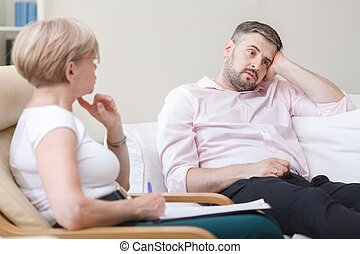Psychologist helping man with depression