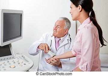 Radiologist Scanning Female Patient's Hand