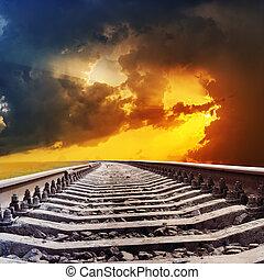 railroad to dramatic sunset