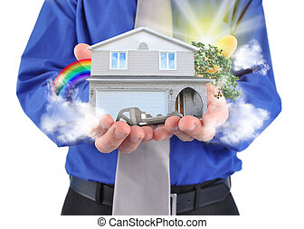 Real Estate House in Hands