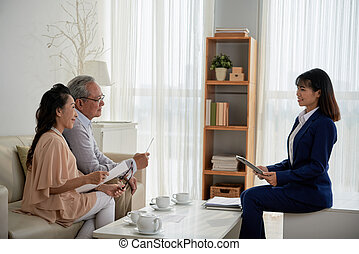Real Estate Manager Helping Senior Couple