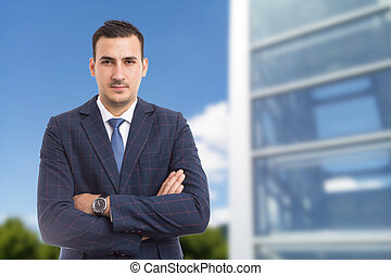 Real estate manager standing confindent with arms crossed