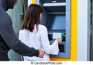 Robber Snatching Card From Woman's Hand Using ATM