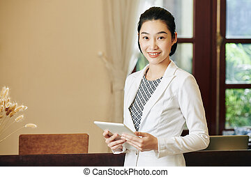 Receptionist with digital tablet