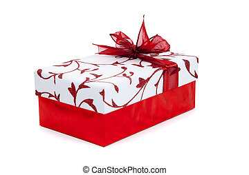 Red and white wrapped Christmas present on white