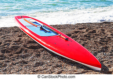 Red board for stand up paddle surfing (SUP)