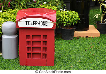 Red british style telephone booth