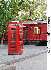 Red British telephone booth in Moscow