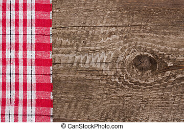 red checkered tablecloth on the old wooden table with copy space for your text. Top view