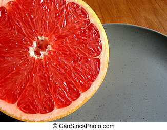 Red grapefruit on plate