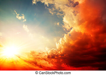 red sunset, bright summer background with sun rays