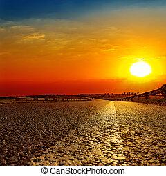 red sunset over asphalt road
