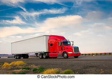 Red truck moving on a highway