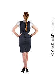 Redhead businesswoman standing with hands on hips
