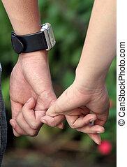 Holding hands in the garden