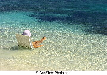 Girl have relax in the warm water of the Indian Ocean