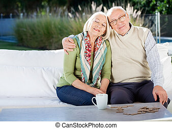 Relaxed Senior Man Sitting On Couch At Nursing Home Porch