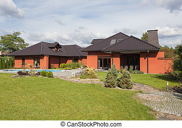 A black and coppery residence with a vast garden