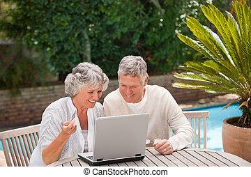 Retired couple buying something on internet