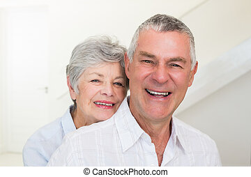 Retired couple smiling at camera
