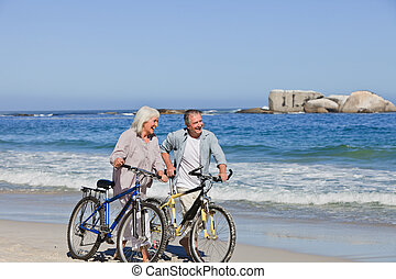 Retired couple with their bikes on