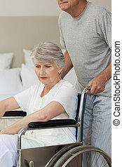 Retired woman in her wheelchair wit