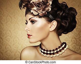 Retro portrait of a beautiful woman. Vintage style. Fashion photo