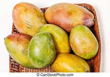 ripe fresh colorful mango in a basket