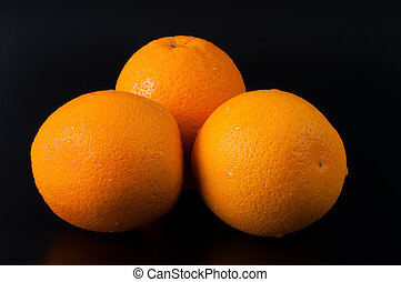 Ripe orange isolated on black background